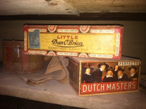 old cigar boxes on a dusty cellar shelf