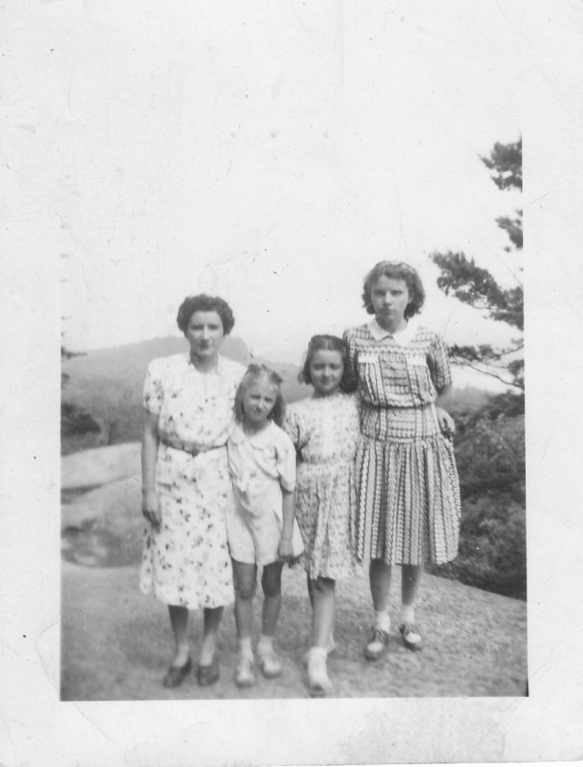 Photo of two adult women and two girls atop Bald Mountain in the Adirondacks.